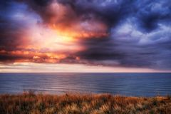 Cape Cod National Seashore Sunset. A dramatic sunset on the atlantic ocean within the Cape Cod National Seashore in North Truro Massachusetts stock images