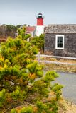 Cape Cod in November. Lighthouse surrounded by colorful trees, Cape Cod, Massachusetts Royalty Free Stock Photos