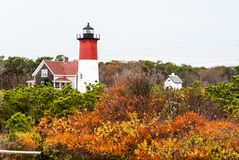 Cape Cod in November. Lighthouse surrounded by colorful trees, Cape Cod, Massachusetts Royalty Free Stock Image