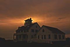 Cape Cod. The sun setting behind an old Coast Guard base on Cape Cod Royalty Free Stock Photos