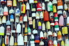 Cape Cod3. Closeup of several colour of buoys hanging on a wall Royalty Free Stock Photos