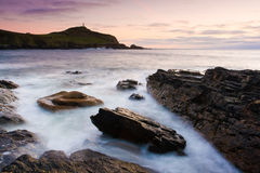 Cape Cornwall. Sunset at the rugged Porth Ledden Cove with Cape Cornwall in the background Stock Photography
