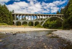 Cape Creek Bridge. Roman Style Arched Cape Creek Bridge Over Highway 101 Along Oregon Coast Near Florence In Lane County Royalty Free Stock Photography