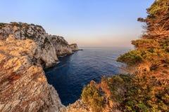 Cape Doukato, Lefkada island, Greece. Lighthouse during sunrise. Cape Doukato, Lefkada island, Greece Stock Photo