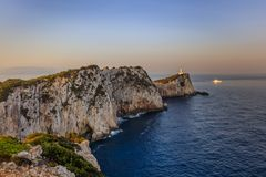 Cape Doukato, Lefkada island, Greece. Lighthouse during sunrise. Cape Doukato, Lefkada island, Greece royalty free stock photography