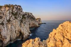 Cape Doukato, Lefkada island, Greece. Lighthouse during sunrise. Cape Doukato, Lefkada island, Greece Stock Images