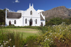 Cape Dutch style church in winelands, South Africa. Cape Dutch syle hchurch in the Cape Winelands, South Africa. Beautiful garden in front Stock Images