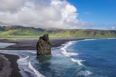 Cape Dyrholaey in Iceland. Aerial view from Dyrholaey cape with black sands of Reynisfjara beach in Iceland stock photo