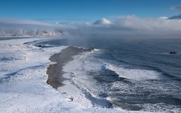Cape Dyrholaey, Iceland. Panoramic image of the coastal landscape of Cape Dyrholaey on a winter day with snow-covered coastline, Iceland stock photos