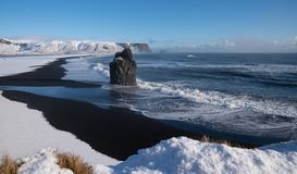 Cape Dyrholaey, Iceland. Panoramic image of the coastal landscape of Cape Dyrholaey on a winter day with snow-covered coastline, Iceland royalty free stock image