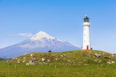 Cape Egmont Lighthouse and Taranaki royalty free stock images