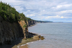 Cape Enrage, New Brunswick, Canada. Dramatic cliifs of Cape Enrage along the Bay of Fundy, in New Brunswick, Canada royalty free stock images