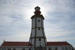 Cape Espichel lighthouse. The lighthouse of Espichel in portugal with the sun behind Stock Photos