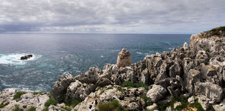 Cape Espichel rocks. Cape Espichel carbonate sedimentary rocks. Sesimbra, Portugal royalty free stock image