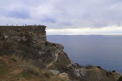 Cape Fiolent. Black Sea. Early spring. Cool and strong wind. The leaden sky, through which the sun`s rays make their way. But the rocks and the sea are royalty free stock images