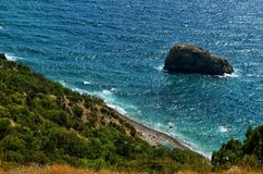 Jasper beach and rock of the Holy phenomenon on Cape Fiolent in Crimea. royalty free stock photography