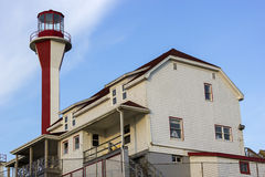 Cape Forchu Lighthouse in Nova Scotia in Canada. On a sunny day stock photos