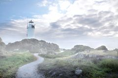 Cape Foulwind Lighthouse in the fog Royalty Free Stock Photos