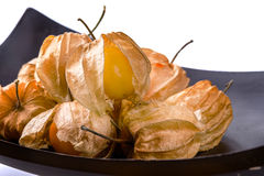 Cape Gooseberry in bowl on white background. Royalty Free Stock Photography