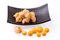 Cape Gooseberry in bowl on white background. Stock Images