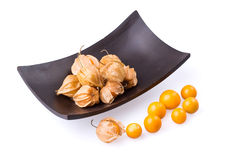 Cape Gooseberry in bowl on white background. Stock Photos
