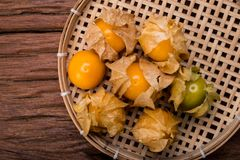 Cape gooseberry. On wood background royalty free stock image