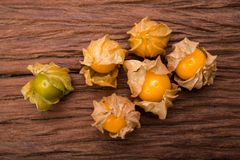 Cape gooseberry. On wood background royalty free stock images