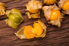 Cape gooseberry. On wood background royalty free stock photography