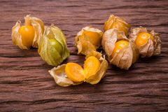 Cape gooseberry. On wood background royalty free stock photos