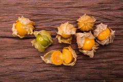 Cape gooseberry. On wood background stock photos