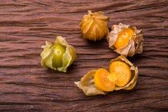 Cape gooseberry. On wood background stock photo