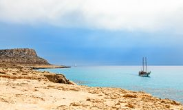 Cape Greco panorama with blue sea and yacht in the foreground, A stock photo