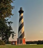 Cape Hatteras Lighthouse Sunset. Cape Hatteras Lighthouse is 198 feet tall and a climb of 268 steps will take you to the top for a view of Hatteras Island and Stock Photography