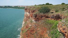 Steep Black Sea coast near Kaliakr cape in Bulgaria. The cape is issued in the sea for approximately two kilometers and is a natural and archaeological reserve stock video
