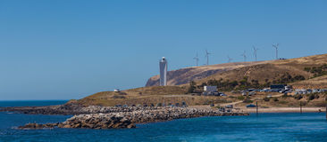 Cape Jervis Lighthouse and windfarm viewed from the sea, South A Royalty Free Stock Photos
