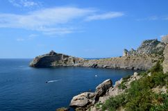 Cape Kapchik in the Black Sea near the village of Novy Svet sunny summer day. Mountain in the form of a dolphin, side view stock images