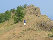 Cape Khoboy. Olkhon Island. Tourists go on a tour stock photo
