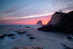 Cape Kiwanda. Colorful sunset in Oregon at Cape Kiwanda with long exposure Stock Photos
