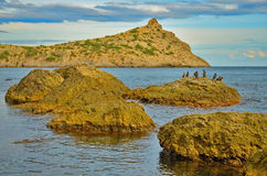 Cape and large rocks in the Bay with a beautiful cloudy sky on the Black sea in Crimea, Novy Svet Royalty Free Stock Photos
