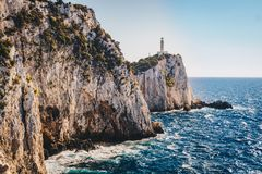 Cape Lefkada or Lefkas lighthouse and cliffs in the southern par. T of Lefkada Island, Greece stock photography
