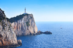Cape Lefkada Lighthouse with steep cliffs and blue sea Royalty Free Stock Photography