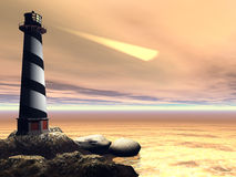 Cape Lookout. A lighthouse shines out to sea to warn passing boats and ships Stock Images