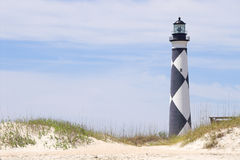 Cape Lookout Lighthouse. A historic lighthouse guiding ships away from rocky shoals Royalty Free Stock Images
