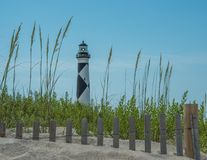 Cape lookout lighthouse. Captured from the beach overlooking the sandy dunes and sea oats Stock Photos