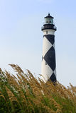 Cape Lookout Lighthouse and Sea Oats. The Cape Lookout Lighthouse, with its distinctive back and white diamond pattern, stands on North Carolina's Southern Outer Stock Photos