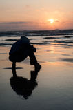 Cape Lookout  sunset closeup with man silhouette sit on the beac Stock Images