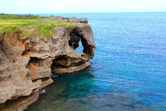 Cape Manzamo. Is a scenic rock formation on Okinawa Island, Japan. It is located near Onna Village in the Kunigami District of Okinawa Prefecture.  is one of Stock Photography