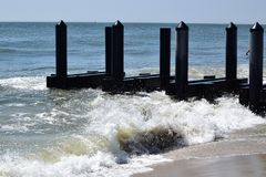 Cape may Beach. Waves on the Cape May new jersey Beach crashing against the shoreline Royalty Free Stock Photos