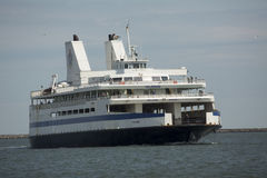 Cape May ferry boat turns into dock at Lewes, Delaware. stock images