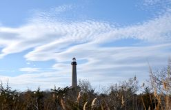 Cape May Lighthouse. In Cape May New Jersey on a blue day with white clouds Stock Photos